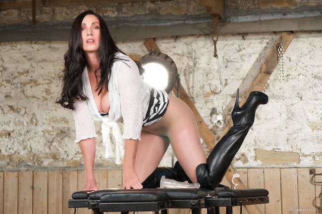 Miss Hybrid leather thigh boots mistress with ripped gusset pantyhose.