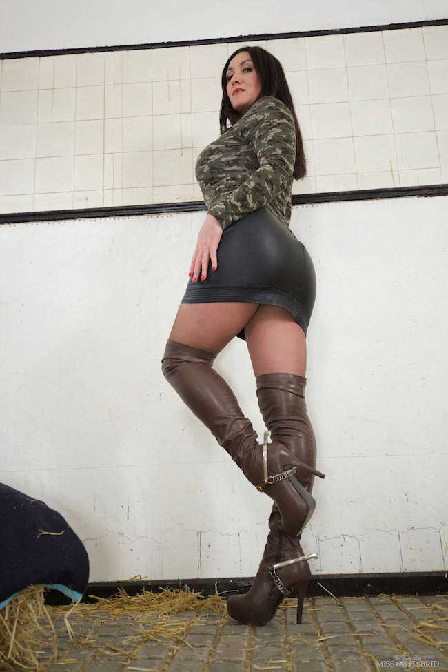 Sexy leather thigh boots and short skirt in the stables.