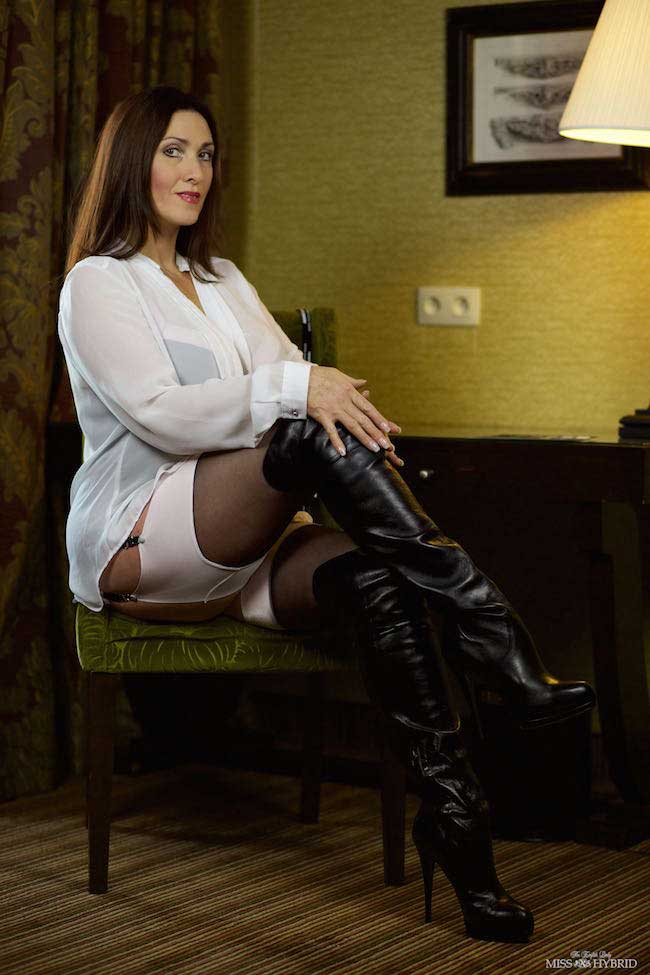 Miss Hybrid sexy stockings suspenders and leather thigh boots.