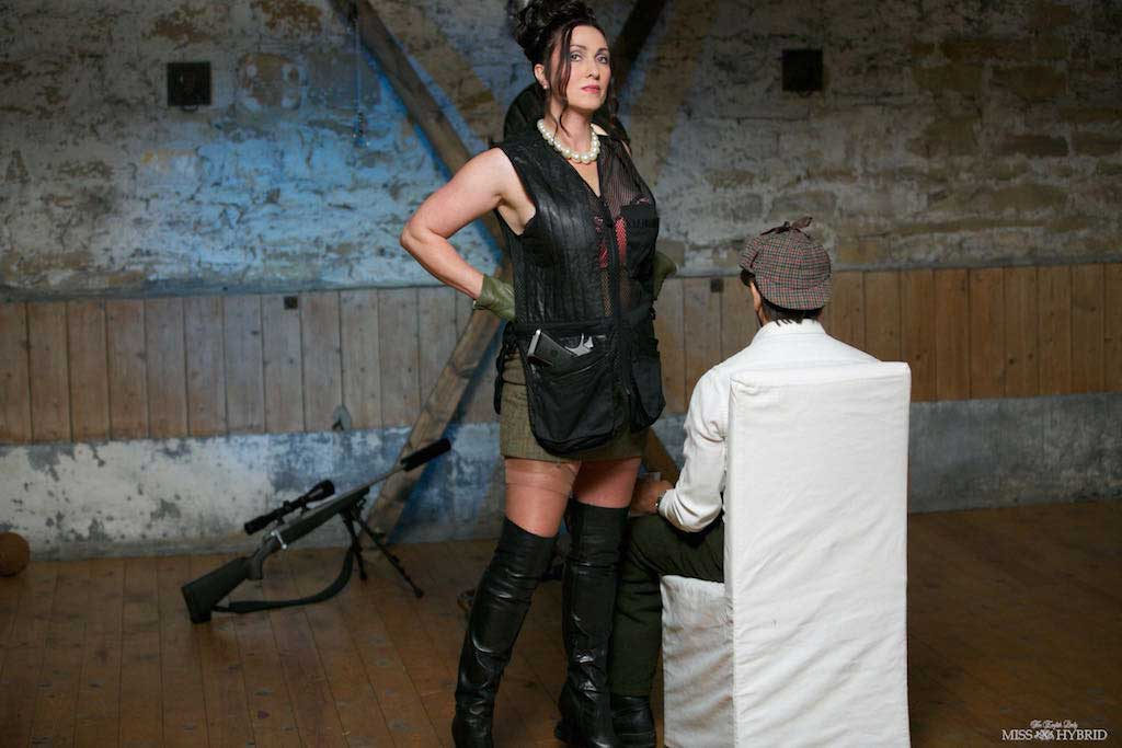 Mistress Miss Hybrid, leather boots and stockings.