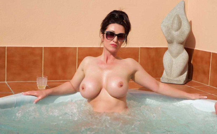 Miss Hybrid sexy glasses, huge tits and hard nipples in the hot tub.