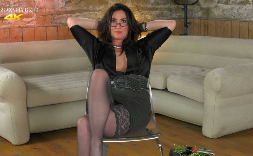 Miss Hybrid stunning mistress huge cleavage, stockings and leather gloves teasing her nipples.