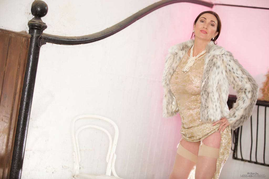 Gold dress pearl thong and gold stiletto heels miss Hybrid beautiful mistress in gold see through dress.