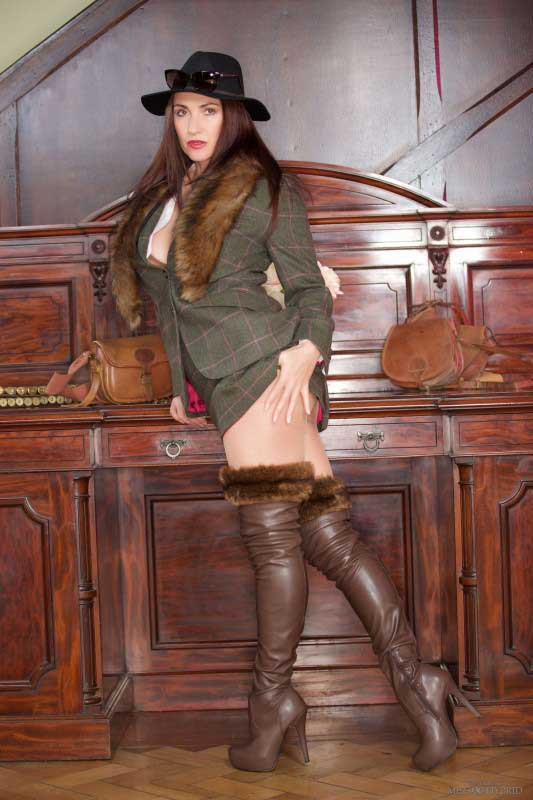 Miss Hybrid new toy hidden inside sexy nylons and leather boots.